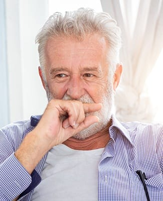 older man covering mouth