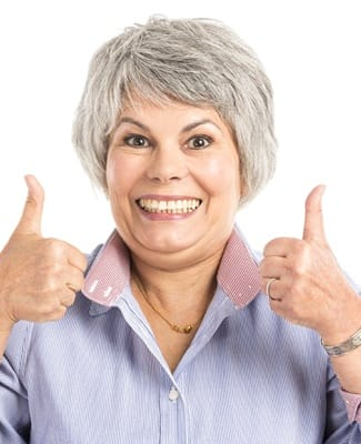 woman smiling with both thumbs up