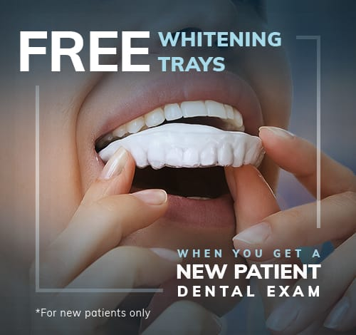 woman putting in whitening tray