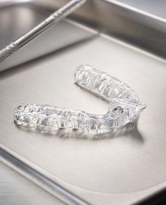 mouthguard on silver tray