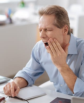 man yawning in pain
